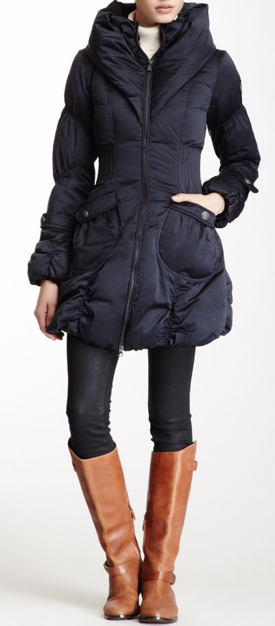 Long winter jacket with fitted waist, dark denim leggings and brown boots. :)