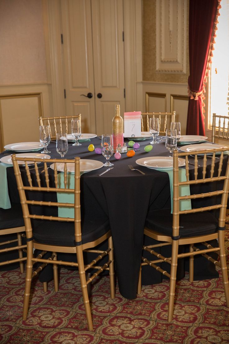 Easter wedding table setting. Mint and coral were my colors, easter eggs on the table with Ferrero Rocher's inside! Black tablecloth and mint napkins.