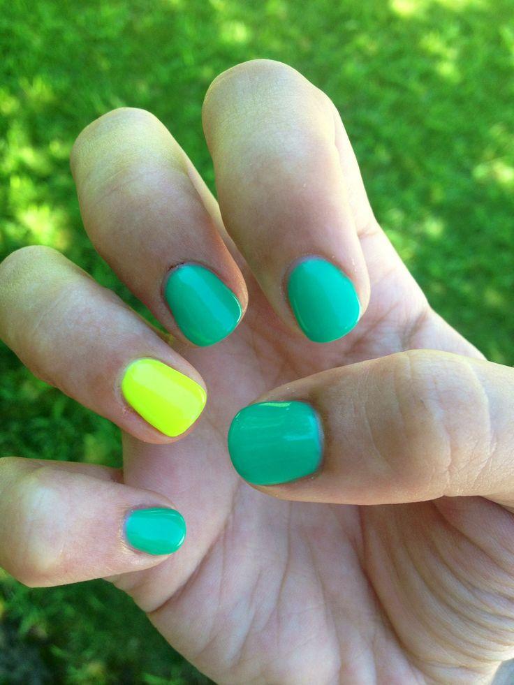 Nails yellow-green semi permanent nail polish.