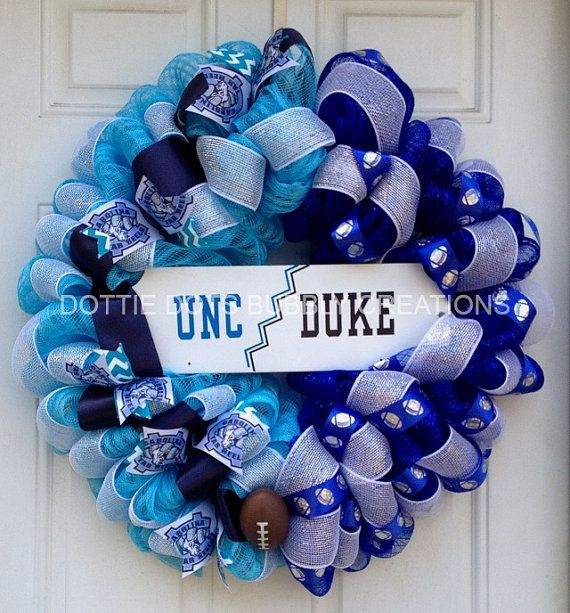 This is a 24 UNC-Duke House divided Mesh Wreath, accented with white metallic mesh, football ribbon, Carolina ribbon, blue mesh. light blue mesh, a
