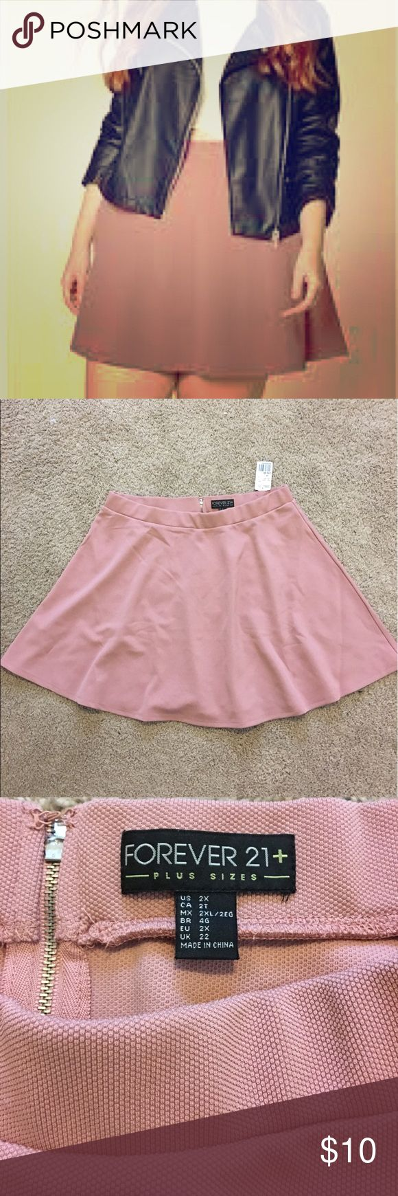 Pink skater skirt forever 21 plus This is a new, never worn pink skater skirt that I got from f21+ but it didn't suit my skin tone. It's textured, and not very structured. There is a zipper in the back. Forever 21 Skirts Circle & Skater
