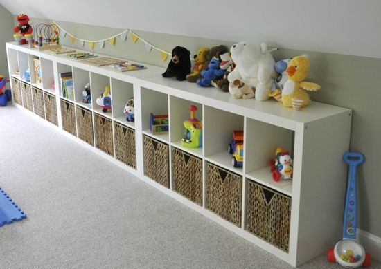 Ikea Expedit in playroom.  Our new house has short walls in playroom just like this.