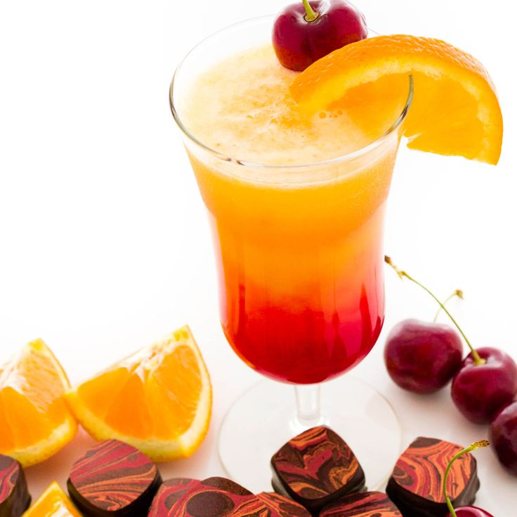 #Tequila Sunrise - The two-toned, sunrise-like appearance of this cocktail makes it as welcome on a cool day as it is on a hot day. #Recipes #FestiveDrinks #HolidayCocktails