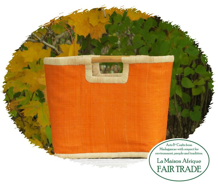 Fair Trade basket handcrafted of natural fibres. Flat top line with bamboo handles. Function with style - outdoors as well as Indoors.