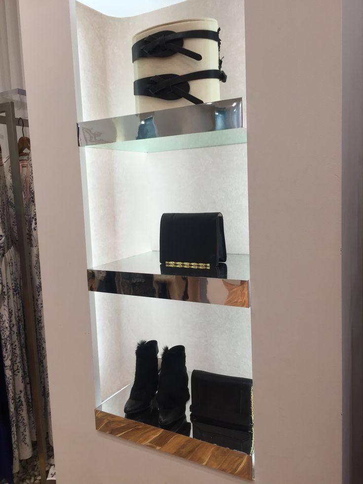 there are some accessories on the wall, is not only can show people the merchandising, but also make interesting of the store.