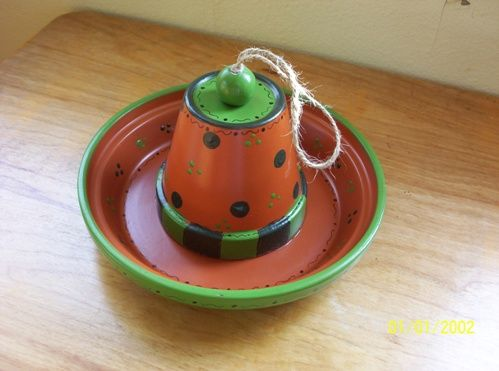 "DIY birdfeeder-Paint, then glue 4"" pot to a large clay dish."
