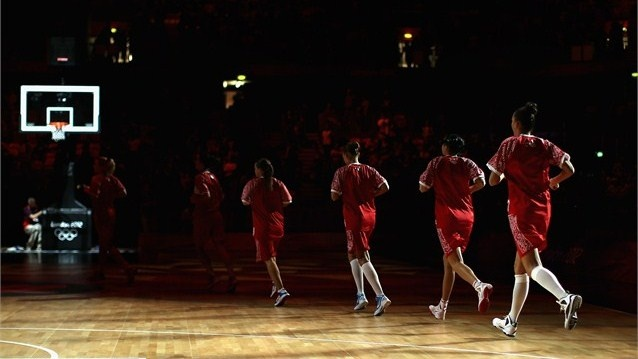 Athletes from Russia run out onto the court before the women's Basketball Preliminary Round match against Great Britain on Day 5 of the London 2012 Olympic Games at Basketball Arena.