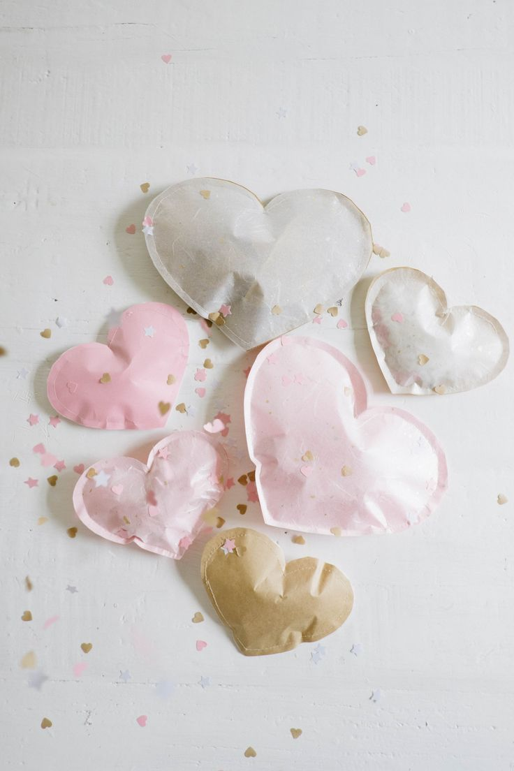 Stitching up paper hearts - a genius idea for Valentine's Day or a special anniversary! #giftwrapping