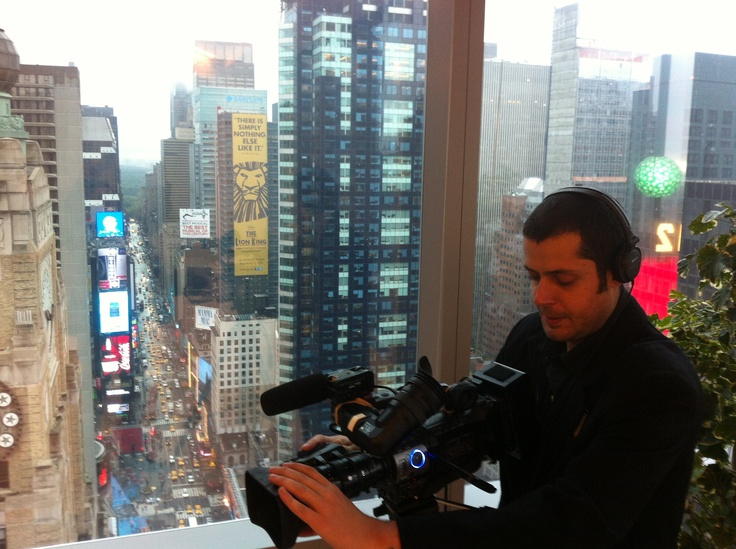 Rainy morning shoot for Gorkana at Thomson Reuters atop Times Square.