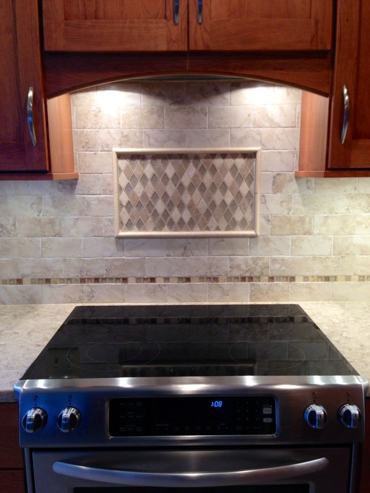 Crossroads Diamond Travertine Tile Bordered With A Cappuchino Mosaic For The Backsplash Piece