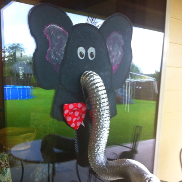 Got the idea from another post on Pinterest but tweaked it a little for my daughters 9 th birthday circus themed party. My mother n law painted the elephant with window chalk and then when put the dryer vent into a bowl of peanuts that guest munched on during the party.