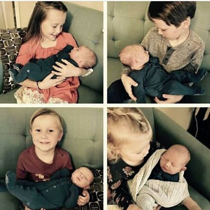 Josh and Anna kids holding their new little brother Mason Garrett Duggar