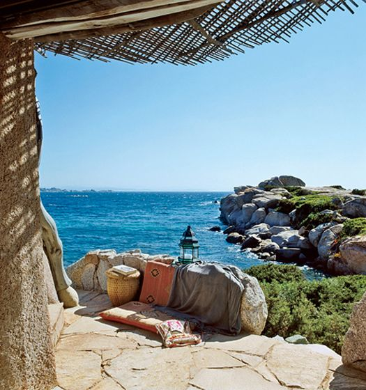 """GUEST ROOM TERRACE: """"I respected the existing environment, the house is married to the land and to the sea,"""" architect Savin Couelle has stated in reference to this incredible home he has designed on the small island of Cavallo, off the coast of Corsica in the Mediterranean Sea."""