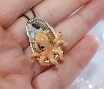 Gold octopus inside a seashell/ pendant necklace jewelry/handmade polymer clay