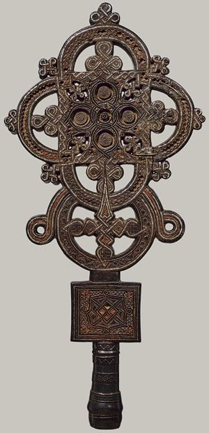 """Processional Cross, 16th century, Eithiopia. """"This cross was created in the province of Tigray, near the Red Sea, the birthplace of Ethiopia's earliest kingdom and of Christianity in Africa.  Underlying this exceptional object's aesthetic is a technically accomplished fusion of wood sculpture and metalwork..."""""""