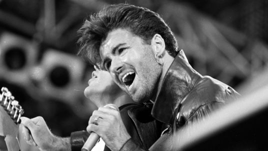 George Michael on stage for Wham's last sell out concert at Wembley Stadium in 1986