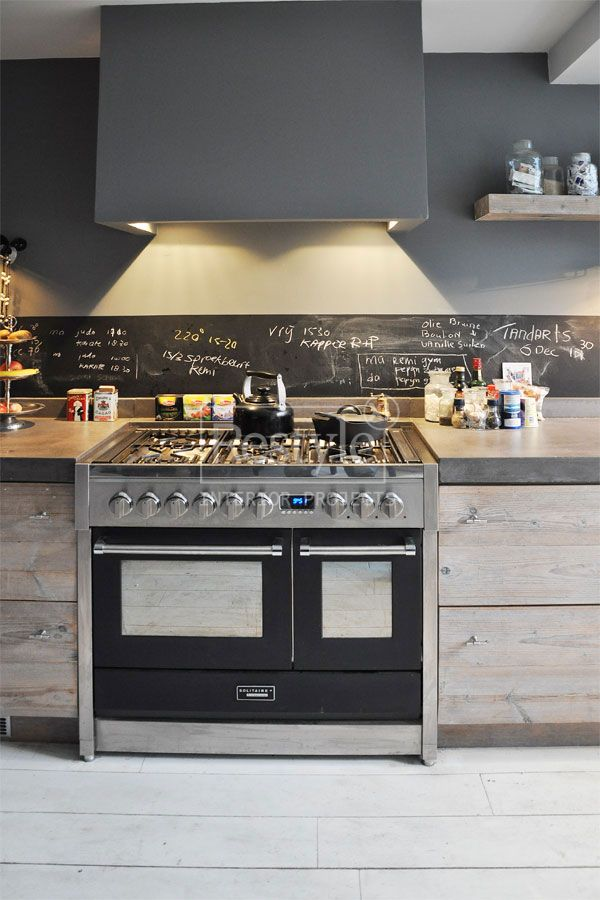 grey kitchen with chalkboard backsplash for recipe notes!