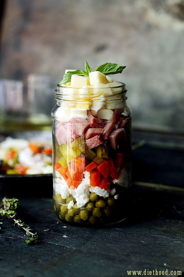 Russian Layered Salad   www.diethood.com   Russian Layered Salad  is a delicious salad recipe made with ham, eggs, cheeses, carrots, peas, and pickles.   #recipes #memorialday #salad #russiansalad