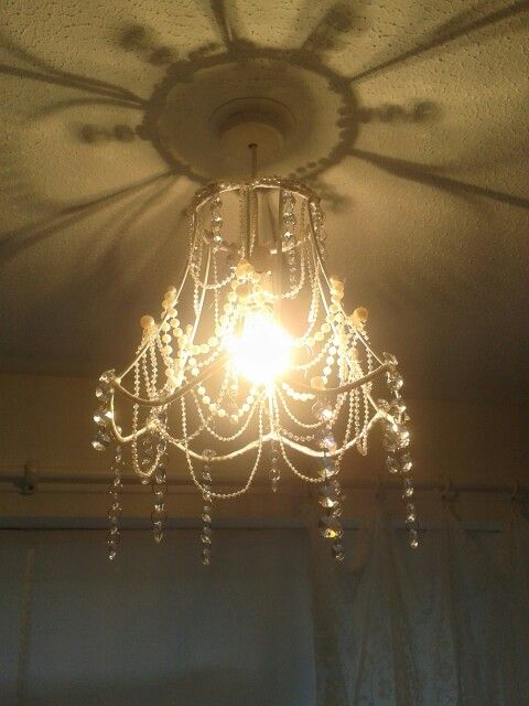My Homemade Chandelier Using Strings Of Pearls Crystals And An Old Lampshade Frame Fixed Together