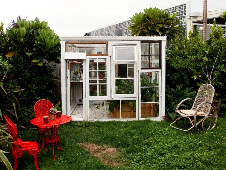 Dozens of windows and one tin roof = ideal DIY greenhouse.  (via Zach Klein's free cabin porn)