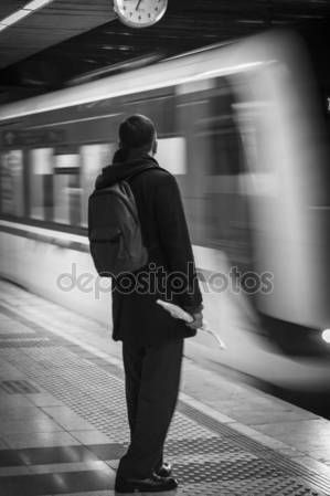Passenger waiting for the metro at subway station - Black and white with creative blurred effect on the train that is arriving – Stock Editorial Photo © carlotoffolo #147823103