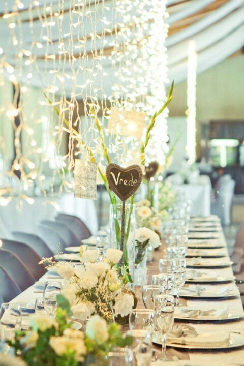 Rustic, farmstyle wedding with lots of fairy lights and white flowers. Flowers by Vergeet - My - Nie www.vergeetmynieflorist.co.za