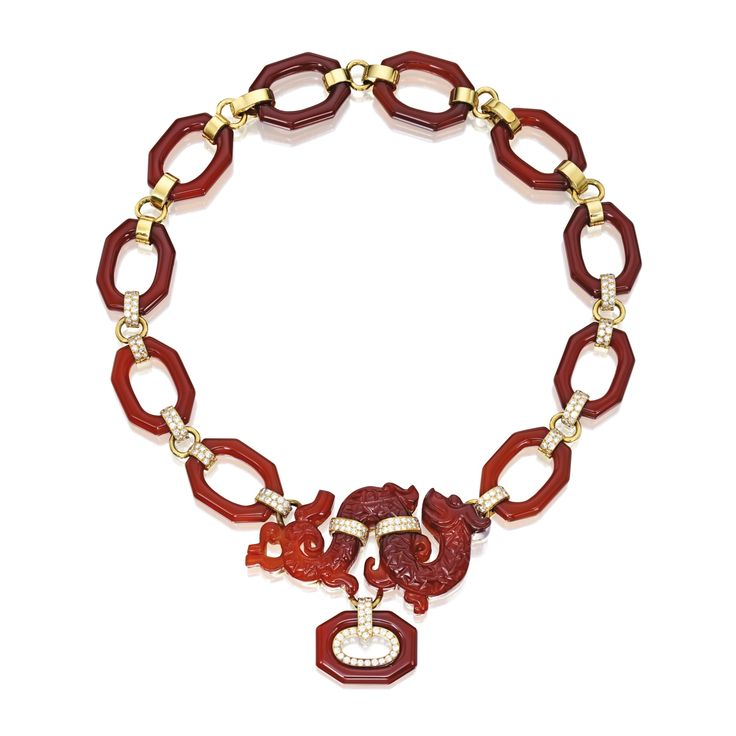 18 Karat Gold, Carnelian and Diamond Necklace, David Webb Composed of octagon-shaped carnelian links with polished gold spacers, supporting a carnelian pendant carved in the form of a dragon, set with round diamonds weighing approximately 7.65 carats, length 20½ inches, signed Webb; three links detach for variety of wear; circa 1970.