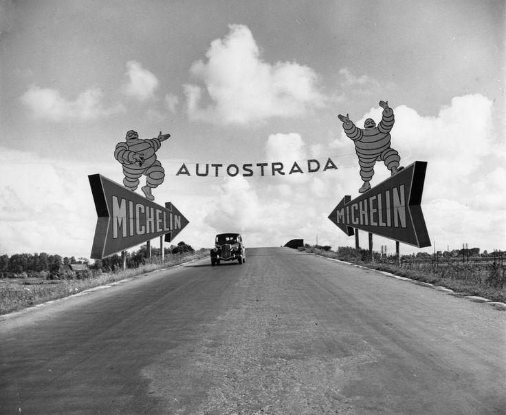 Michelin man billboards, Torino-Milano autostrada (1947) | Photographer: Alfred Eisenstaedt