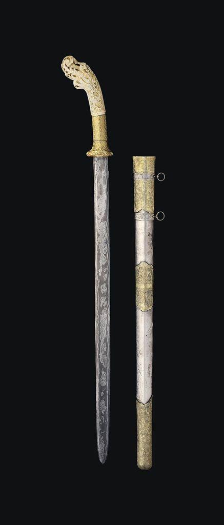 A SUMATRAN IVORY HILTED SWORD -  SUMATRA, INDONESIA, LATE 19TH/20TH CENTURY