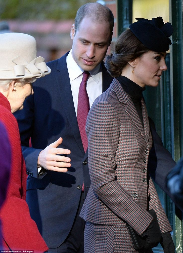 Prince William protectively places a hand behind his wife Catherine, Duchess of Cambridge back as she enters the St. Mary Magdalene Church in Sandringham for a service marking the 100th anniversary of the First World War Gallipoli campaign, January 10, 2016.
