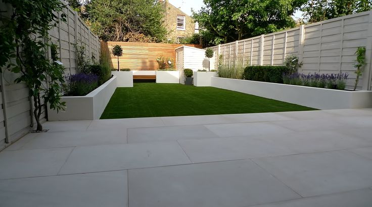 Modern london garden design smooth sawn beige sandstone paving raised block paving walls - Garden ideas london ...