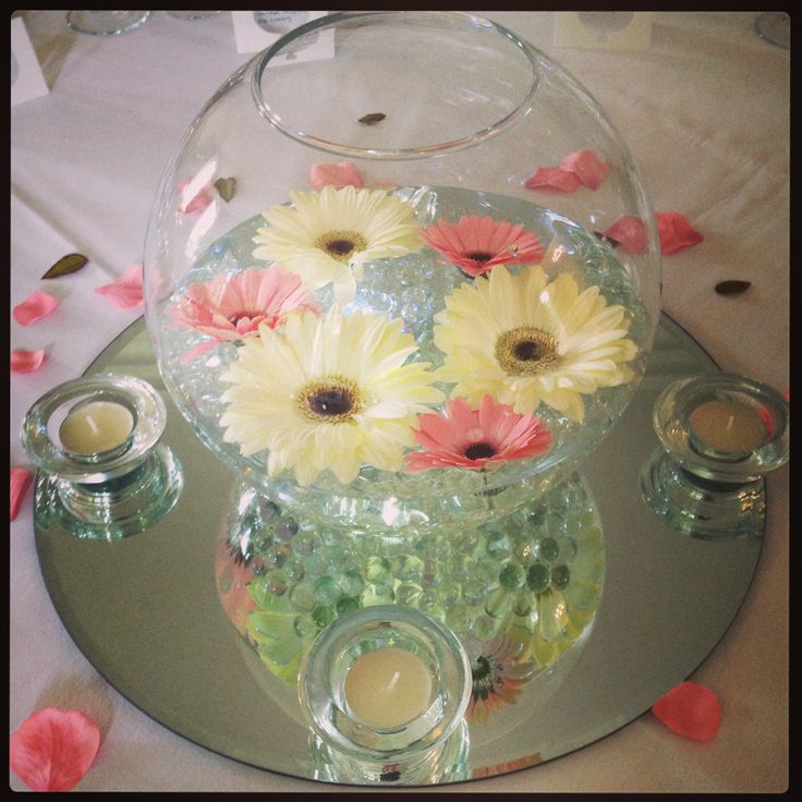 The 25 best fish bowl vases ideas on pinterest for How to make flowers float in vases