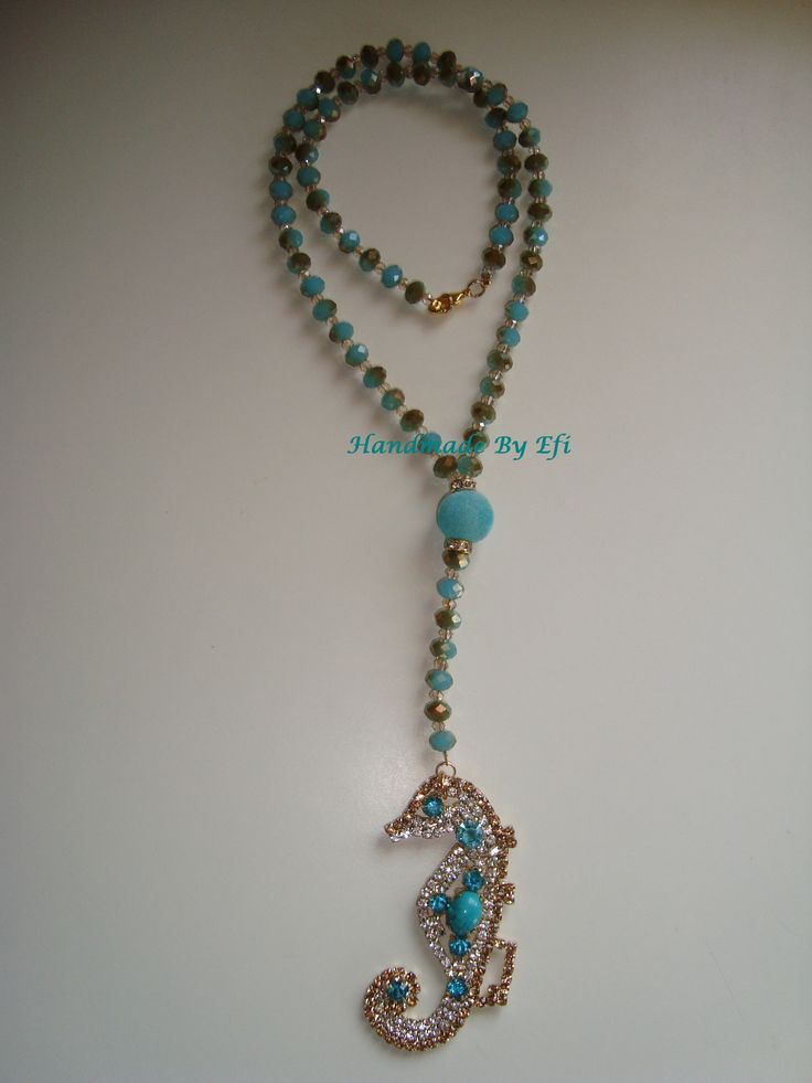 https://www.facebook.com/pages/Handmade-Creations-by-Efi/187659788043676  long necklace , rosary type with seahorse...