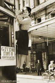 Melbourne conductress changing the tram route number in the city during World…