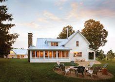 Farmhouse Backyard. Adirondack Chairs, Backyard Firepit ,chimney Pipe,  Metal Roof, Stone