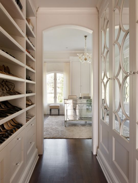 Built-in shoe shelves, mirrored dresser, and beautiful closet doors.