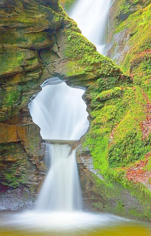 This sacred site at Saint Nectan's Glen, where the River Trevillet has carved through Late Devonian Slate and created a 60 foot waterfall and then punched a hold through the basin for the water to flow, Cornwall, England