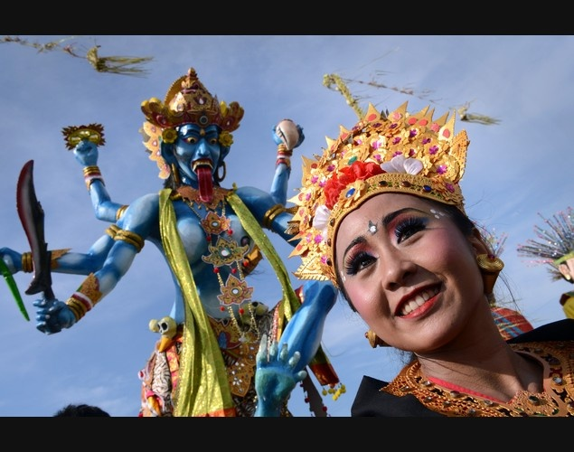 Hindu devotee parades with 'Ogoh Ogoh' effigies during Nyepi or Day of Silence