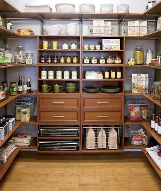 A walk-in pantry in our final home. I love the space in here for my pots and pans and baking necessities. I like the easy access to everything. LOVE the drawers!
