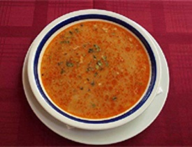 Tripe Stew - Ingredients: 1.5 kg lining of the stomach, little wine, 1 hot pepper, 1 bundle of kerevis, garlic, red pepper, black pepper, salt, flour, oil. Preparation: Chopped in small pieces, the entrails are boiled with vine, garlic, dry pepper, kerevis and salt. Make roux out of oil, spoonful of flour and red pepper. The roux is used on the stew. The stew, then, boils for 10 more minutes.