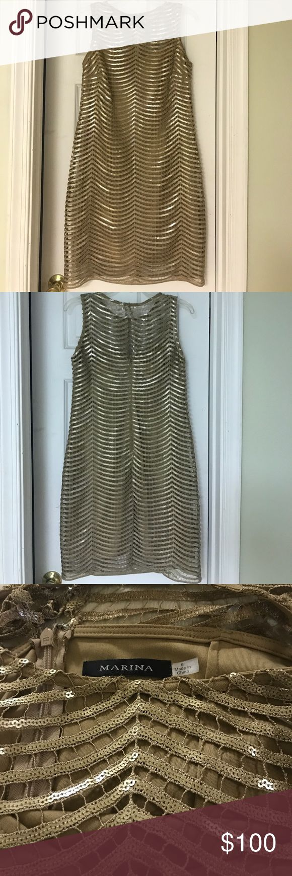 Special occasion beautiful dress So gorgeous very elegant more in person gold with sequence and linen, perfect for a party you will shine, immaculate condition. I bought in Nordstrom store. Marina Dresses