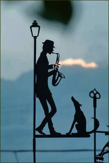 lamppost musician with dog