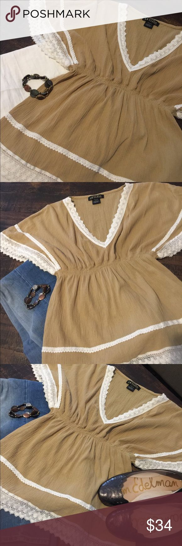 Cute, V neck top💥NWOT💥reduced Really cute, tan, V neck top with cream lace embellishments around sleeves, neckline, & bottom. Empire waist. Size is large, but definitely more like a medium fit. NWOT-never worn. Smoke free home. LA CLASS Tops