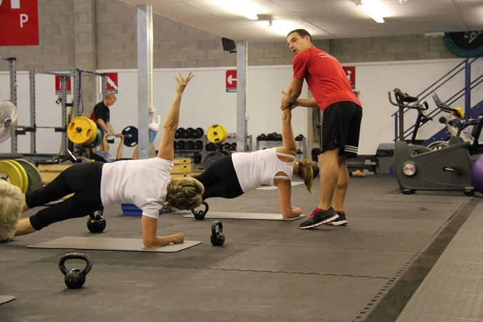 One of our trainers ensuring that exercises are done correctly and safely
