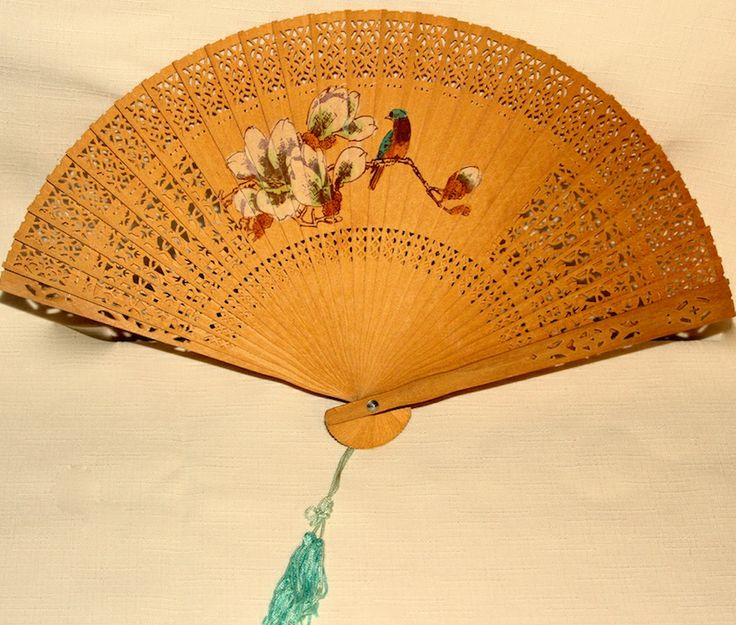 This fan is made of thin filigree wood with a painted design on both sides  # OF-94579 $7.95