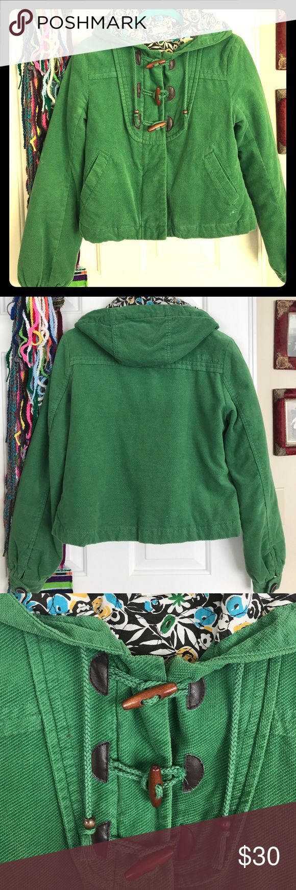 O'Neill Kelly Green Jacket size Medium Super cute Women's O'Neill jacket in size medium. It's jelly green outside and the inside is an adorable floral design. It zips up and also has 3 toggle buttons. Has a hood and is a very soft 100% cotton material. O'Neill Jackets & Coats