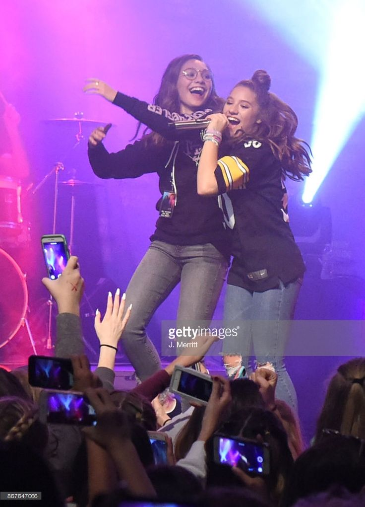 Maddie Ziegler celebrates on stage with Johnny Orlando & Mackenzie Ziegler during their 'Day & NIght' tour at Mr Smalls on October 28, 2017 in Millvale, Pennsylvania.