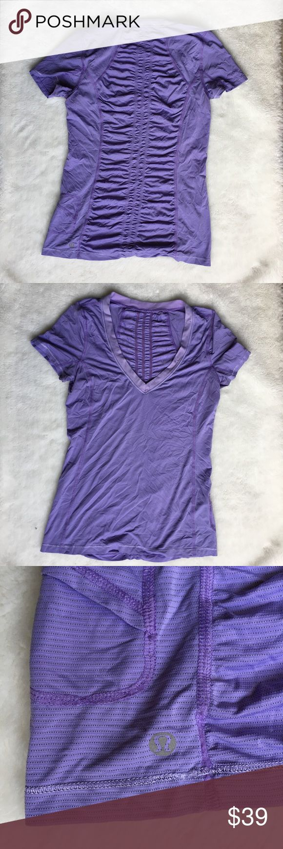 Lululemon Purple Short Sleeve Top size 4 Preowned authentic Lululemon Purple Short Sleeve Top size 4. No builtin bra or pads. Rouched back detail.  Please look at pictures for better reference. Happy shopping!! T1 lululemon athletica Tops Tees - Short Sleeve