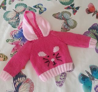 A trendy knitting pattern for a hoodie featuring a cute Mouse for ages 0 to 7 years.