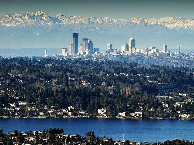 Seattle, view from east to west, Lake Washington in foreground, Olympic Mountains in background.